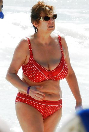 Old ladies with big tits in a swimsuit on the beach