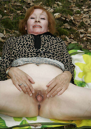 Red headed granny gets fucked in the forest